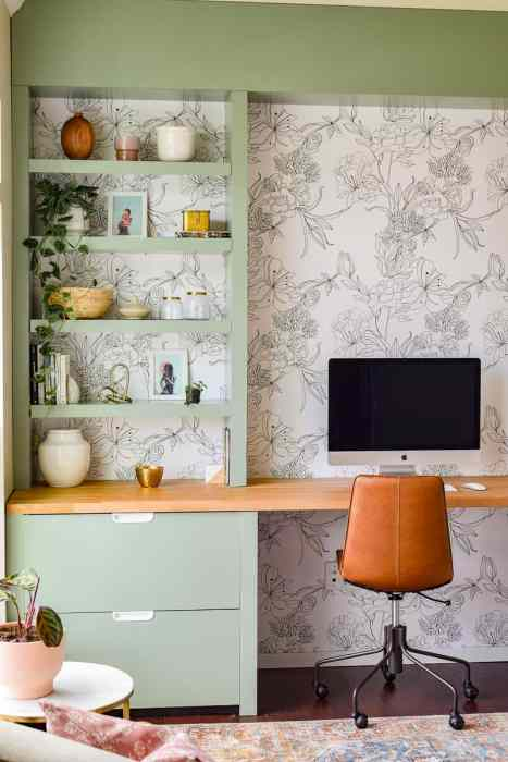 Sharing the big reveal of our formal living room turned modern office space. We used various IKEA pieces, including a butcher block countertop, and Home Depot lumber to make a custom built in desk. We made DIY floating shelves, modern floral wallpaper, and tons of plants to decorate. Modern office ideas   office decor   modern wallpaper   peel and stick wallpaper   one room challenge   DIY office   office renovation   office makeover   office ideas   modern office design   modern office home   home office   modern office space   home decor #oneroomchallenge #modernoffice #officereveal #officemakeover #homedecor #diy