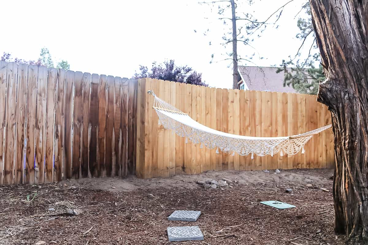 shows a wooden fence with a hammock