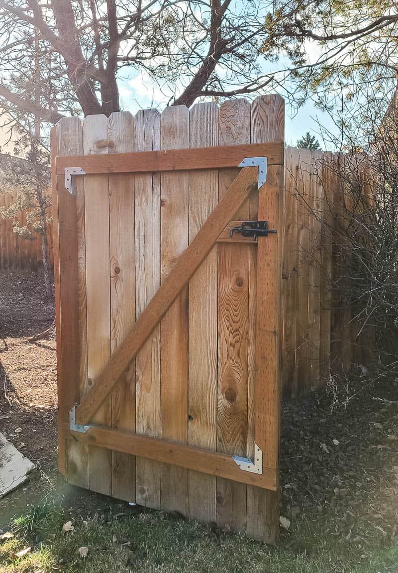 Open wooden gate in the backyard