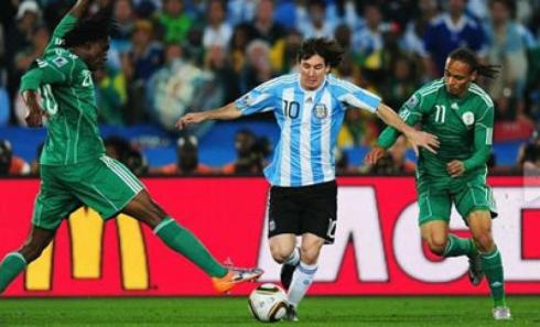 Lionel Messi darts past Osaze Odemwingie and Dickson Etuhu at the 2010 Word Cup -  who will come out on top on June 25th in Porto Alegre?