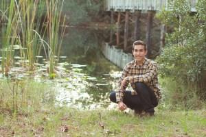 Timothy by lake and bridge