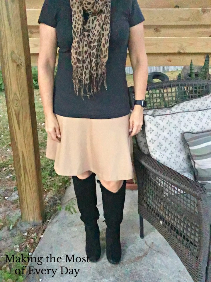 Black boots, with khaki skirt, black tee and leopard scarf. A black and tan!