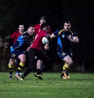 Tadiwa playing rugby against team
