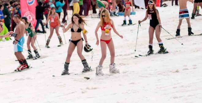 People skiing in swimsuit