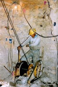 Potosi miner operating machinery