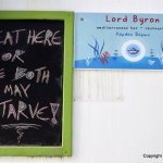 Sign by a taverna, Ios