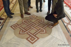 The tiles of every floor are decorated with the pattern of the building.