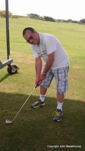 John Malathronas playing golf