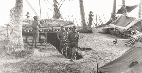 Malaysian forces man observation posts set up on the rugged coast of Sabah during the confrontation with Indonesia.