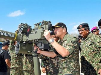 Hishammuddin manning the latest surface to air defence system with his deputy Datuk Mohd Johari Baharum second from right during a test fire at Tanjung Logok in Kota Tinggi.pic Star Online