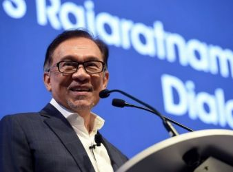 Former Malaysian deputy prime minister Anwar Ibrahim speaks at the Singapore Summit in Singapore on September 15 2018
