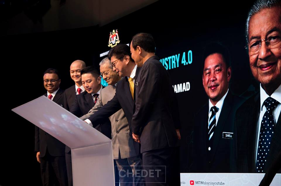 Dr Mahathir during the launch gimmick for Industry4WRD yesterday
