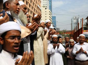 Muslims in Dhaka Bangladesh pray for the victims of Christchurch mosque attack in New Zealand after Friday prayers Reuters
