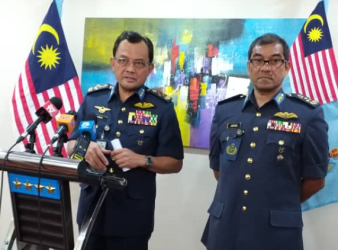 RMAF Chief Datuk Seri Ackbal Abdul Samad left at the press conference in the Ministry of Defence Kuala Lumpur Tuesday January 7.