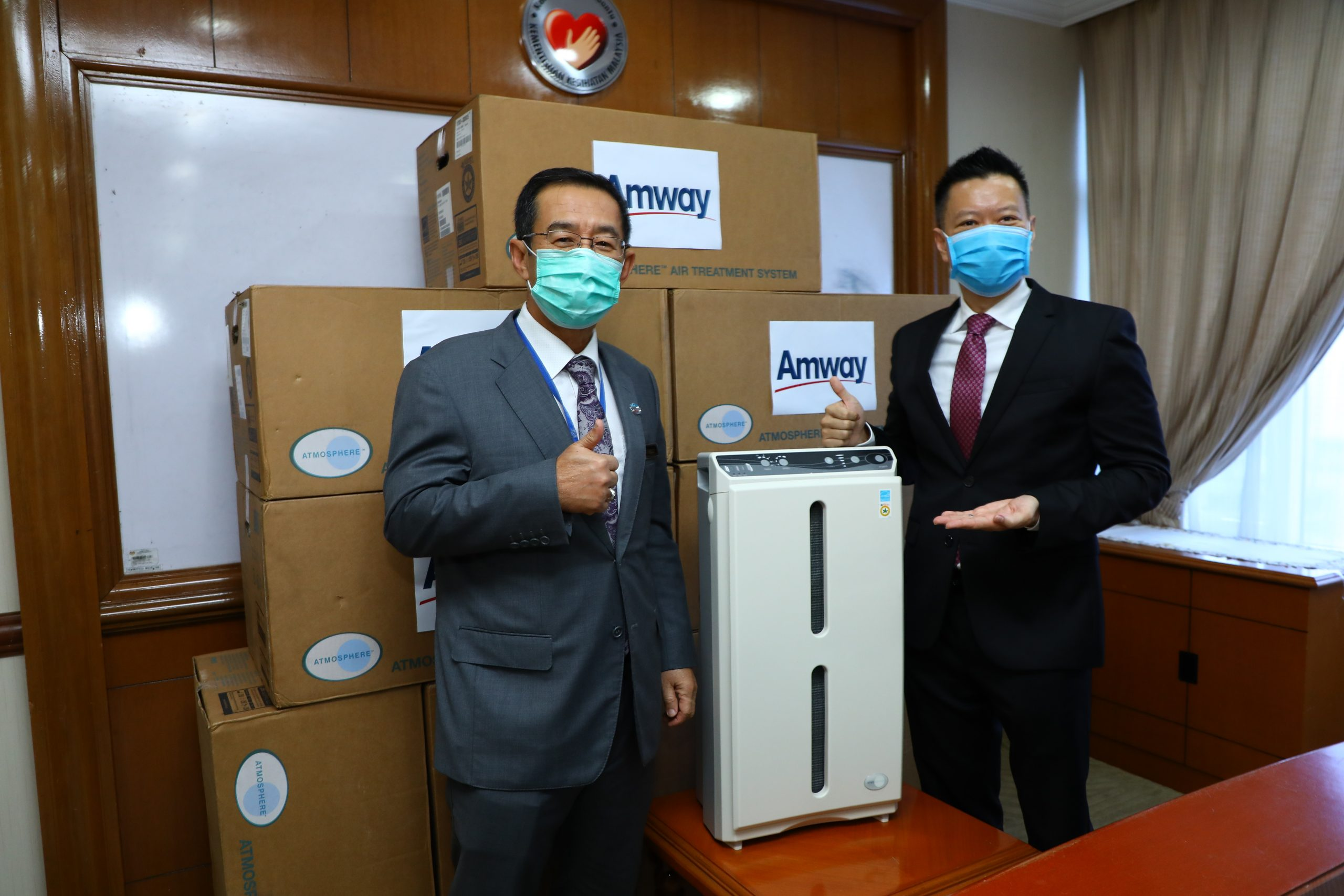 R Ministry of Health Secretary General Datuk Seri Dr Chen Chaw Min receiving Atmosphere units from Mr Mike Duong Managing Director of Malaysia Singapore and Brunei scaled