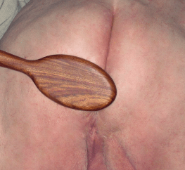 The spanking spoon against Lion's ass