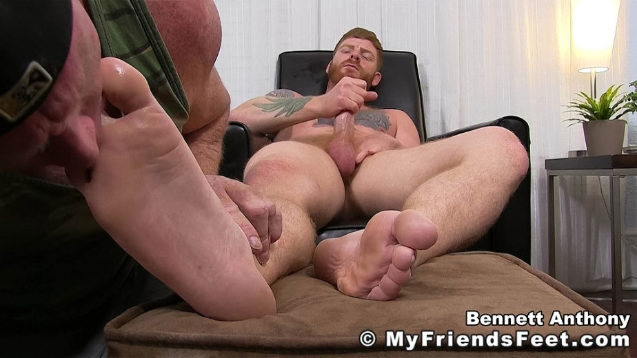 Bennett Anthony strokes his cock while Dev sucks on his toes