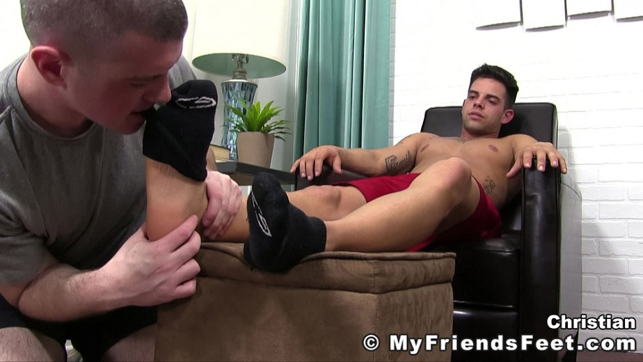 Travis starts to pull off Christian's size 11 black socks with his teeth - My Friends' Feet - male foot fetish porn