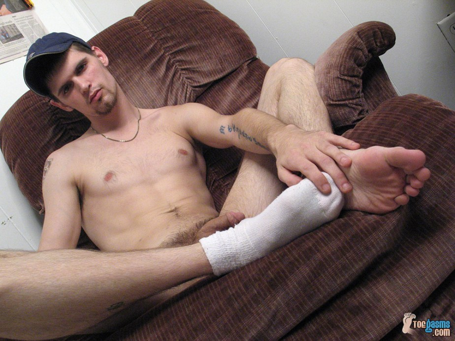 Nolan massages his white socked foot and bare male sole for Toegasms
