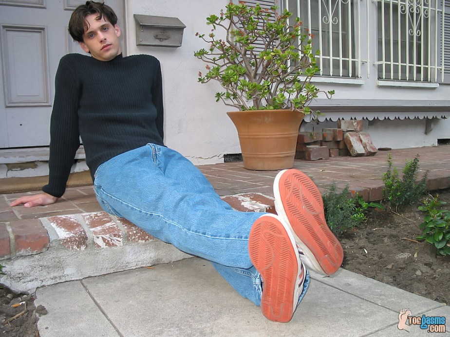 Jared shows off his Adidas sneakers outside for Toegasms