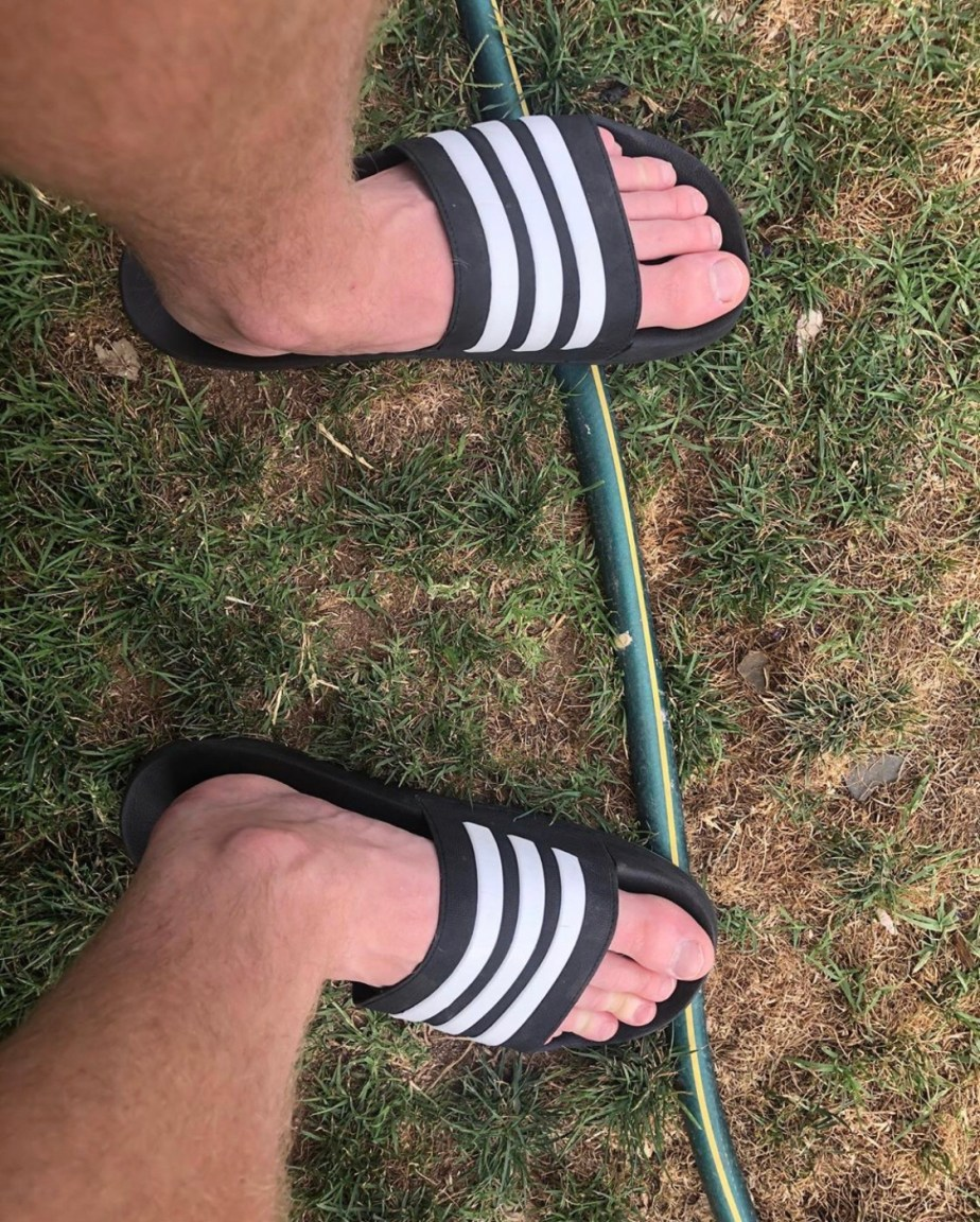 Smellysocksummit's size 13 feet in Adidas slides