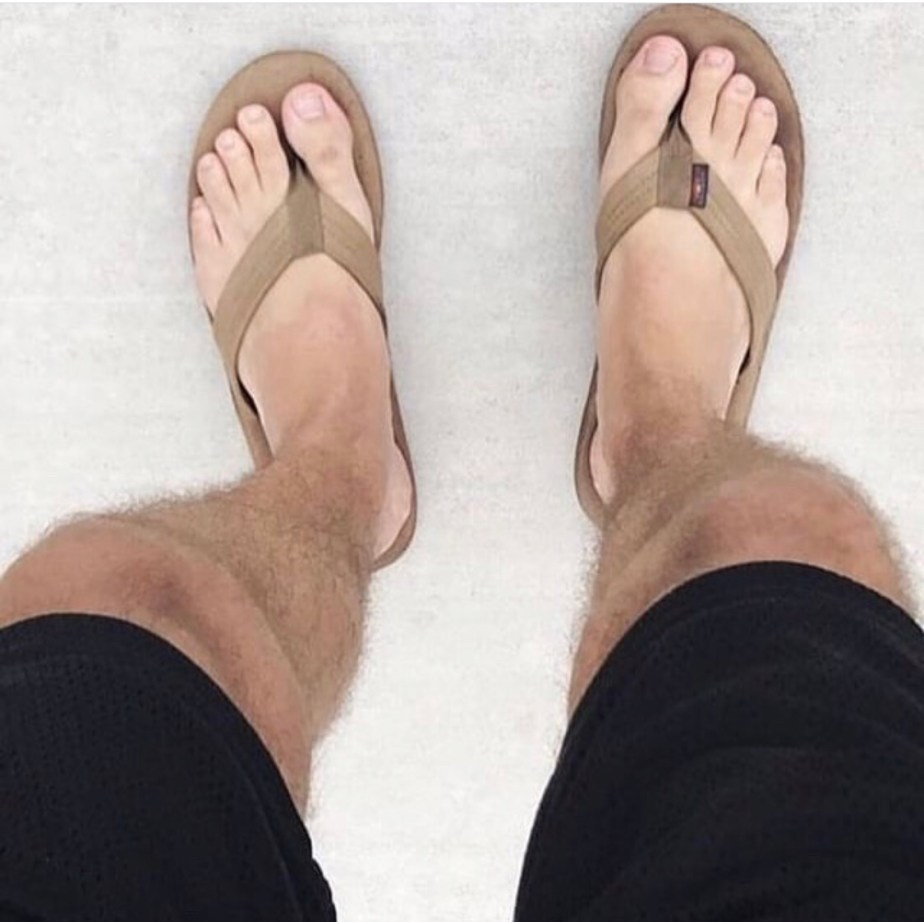 Bare legs and feet in flip flops