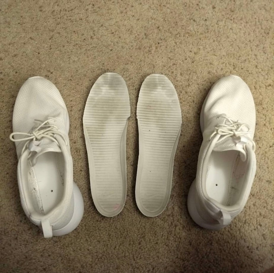 Worn Nike Roshe insoles with size 14 footprints