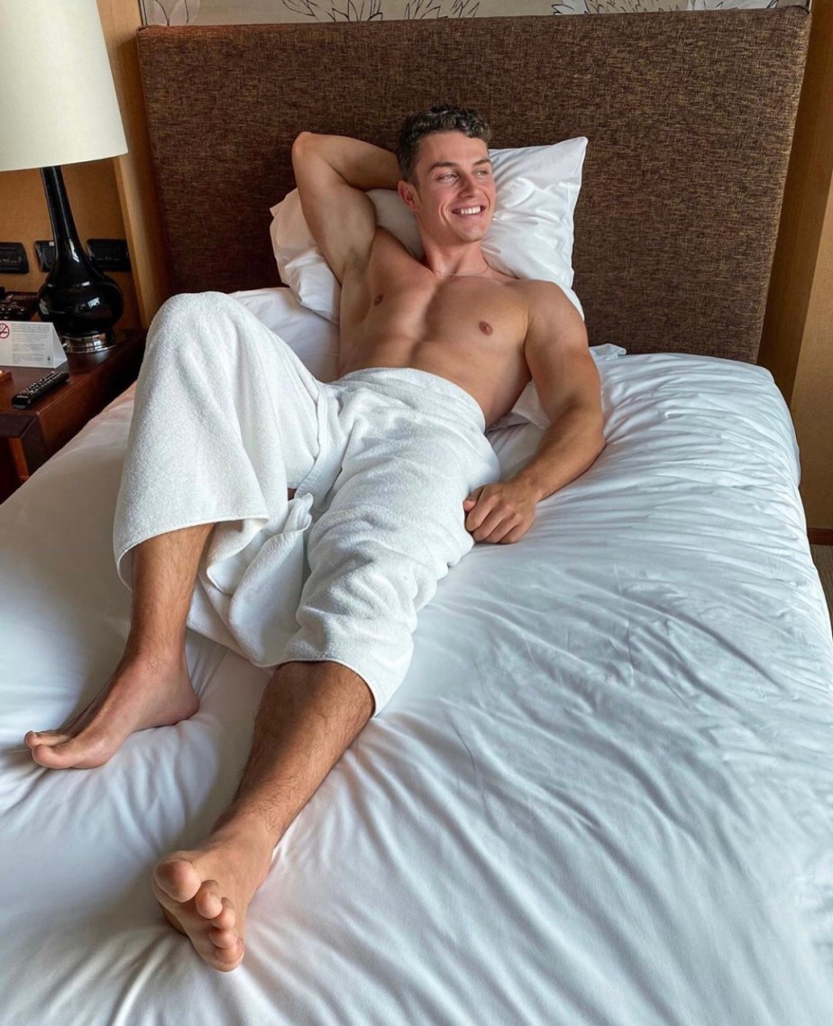 Benjamin Bruening shirtless and barefoot in bed