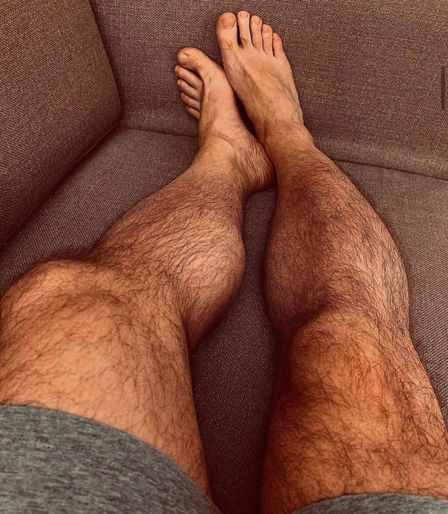 Mixuhel's legs and bare feet on the couch