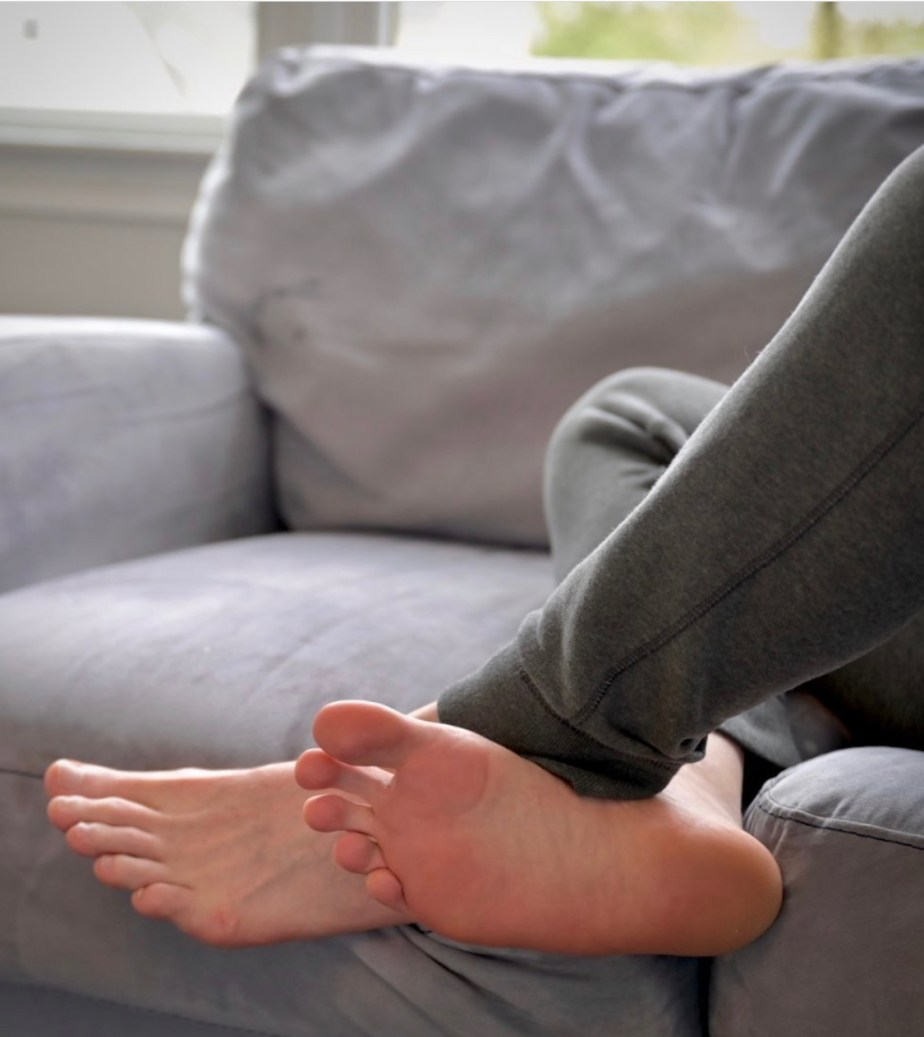 Cptpicard1196's bare soles hanging off the couch