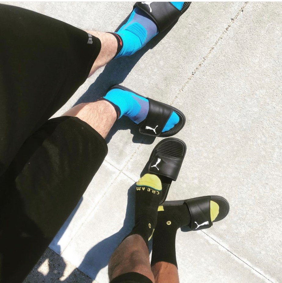 Boyfriends crewsoxlover show off their size 10 and 10.5 feet in crew socks and Puma slides
