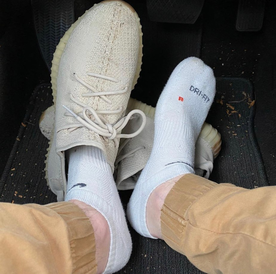 Justinpageft's white Nike ankle socked feet slipping out of adidas Yeezy sneakers