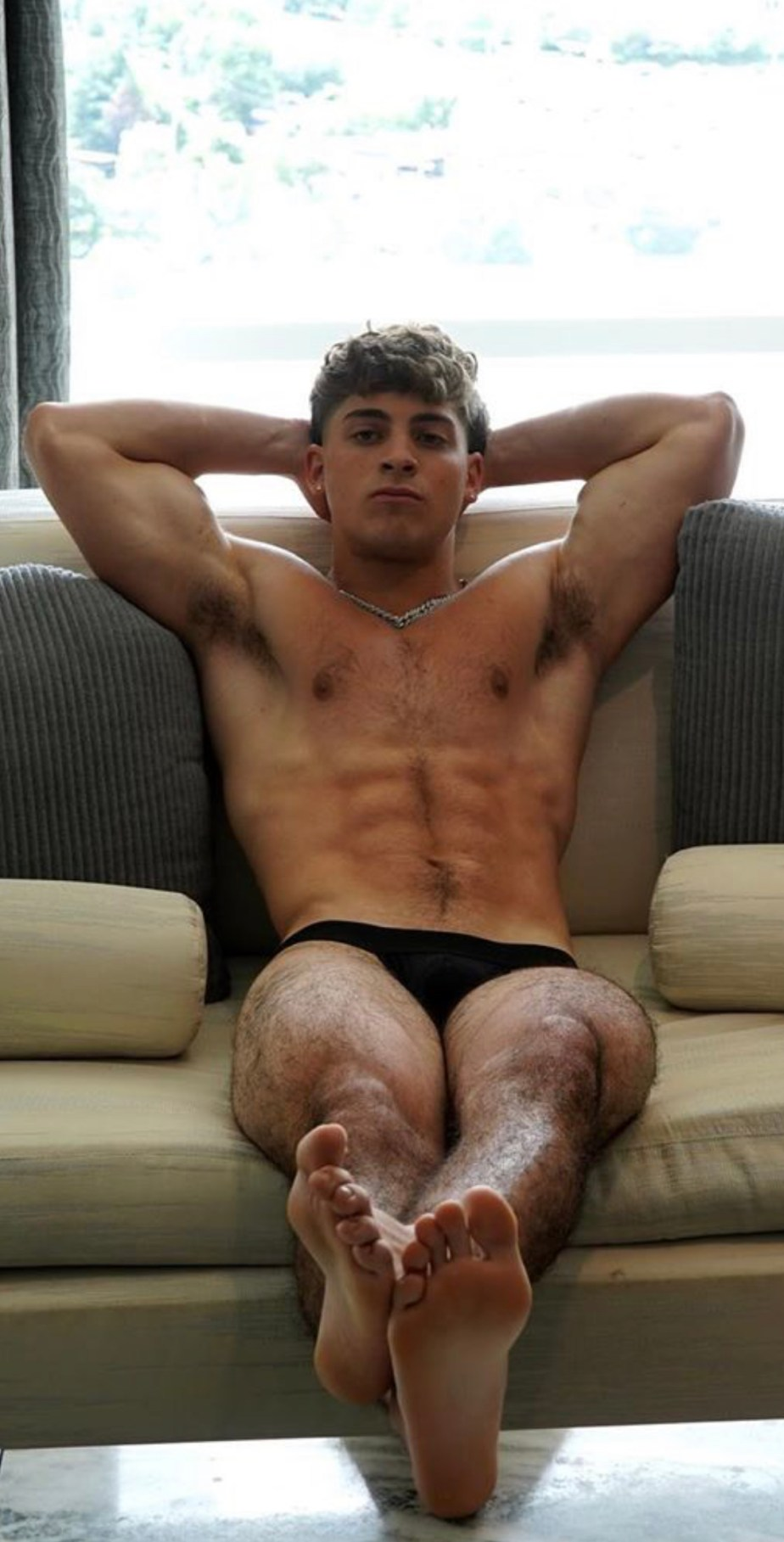 Shirtless realflexmasterjoe shows off his armpits and bare soles