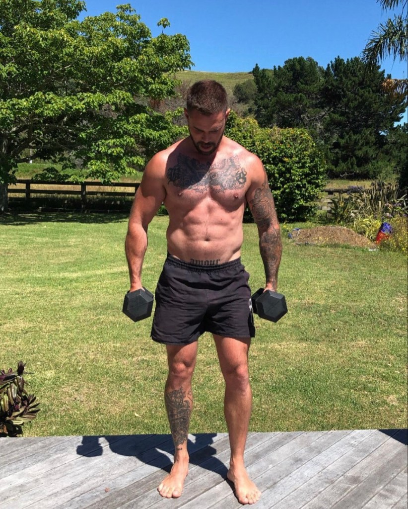 bradengoldsworthy bearded, tattooed, shirtless and working out barefoot