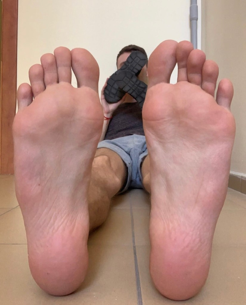 Myjacksfeet sniffing his shoes and showing off his size 10 bare soles