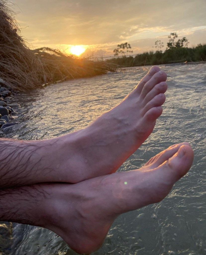 r98feet's bare feet with a sunset