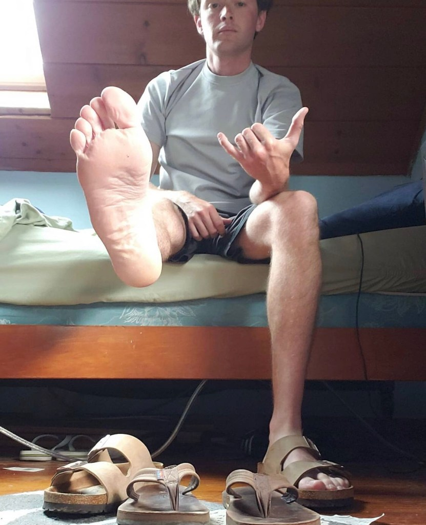 myrainbowflips shows off his bare sole out of Birkenstock sandals
