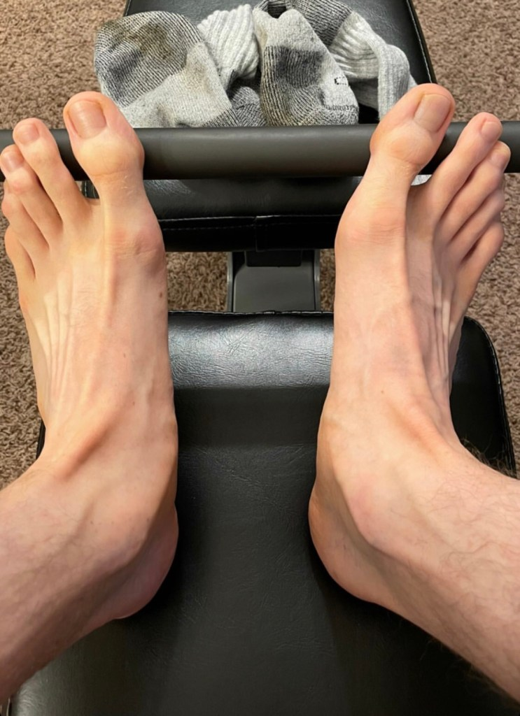 thatmidwestfootguy's bare feet out of socks while working out