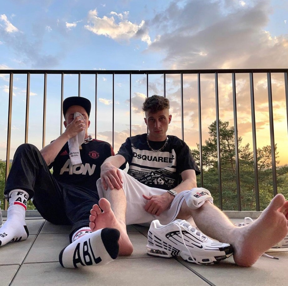 2soxguys sniff and show off their white crew socks and show their bare soles