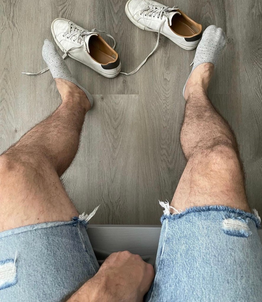 michael_monroe89 shows off his hairy legs and gray ped socks out of sneakers