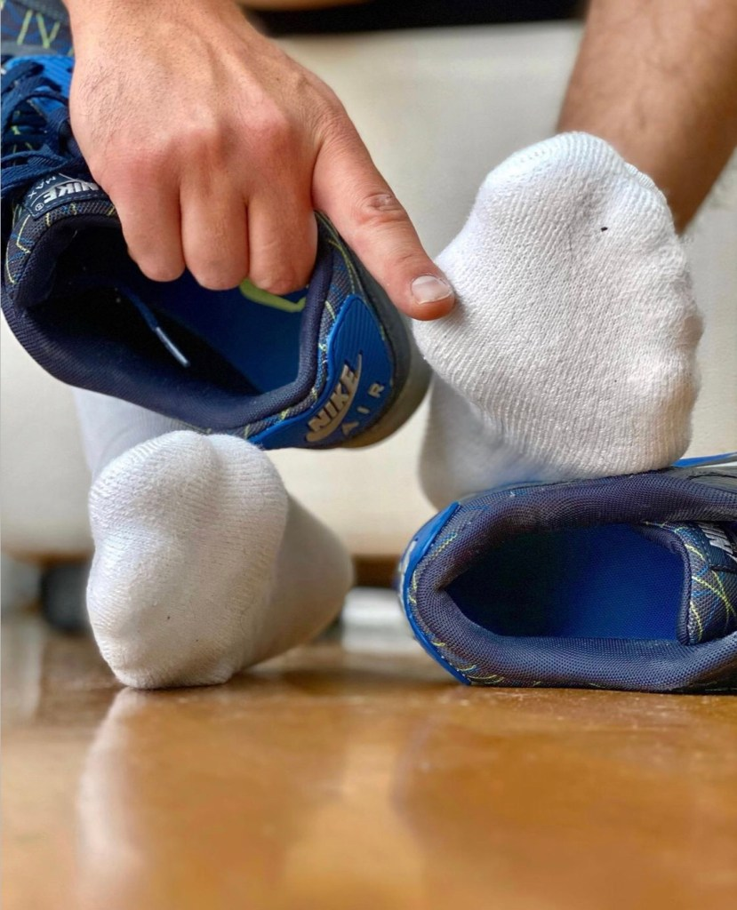 airmax.sniffer shows off his white socked feet out of Nike Air sneakers