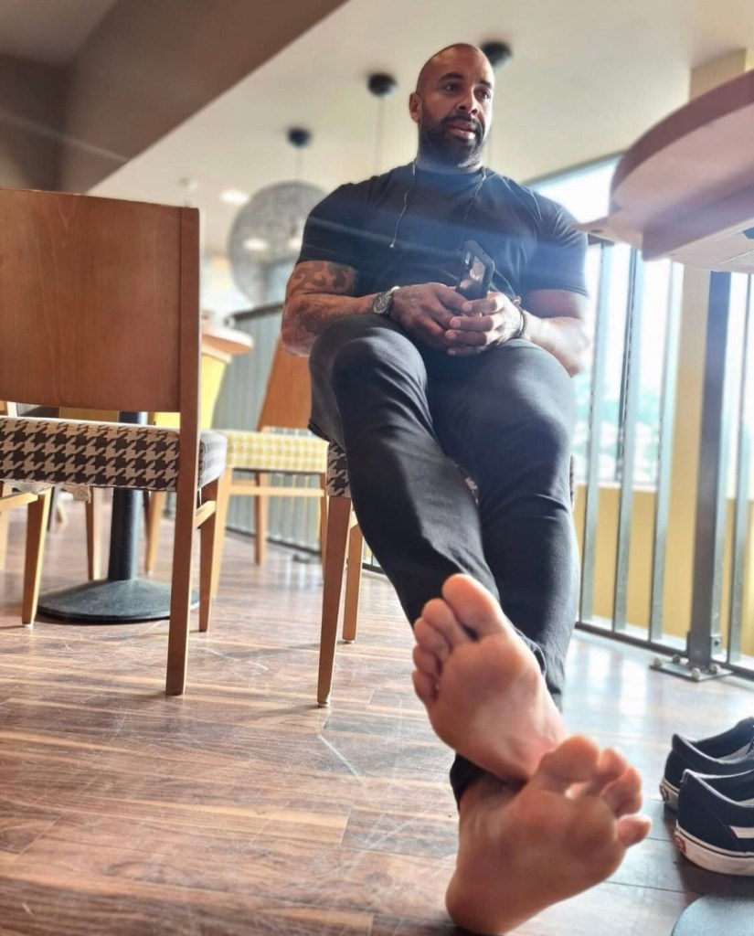 bodybuildinggiantofficial bearded and barefoot out of Vans sneakers