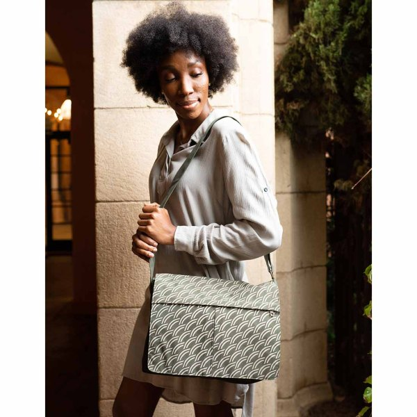 women with army green messenger bag