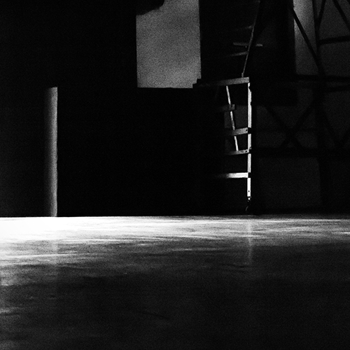 light reflections on an empty stage floor