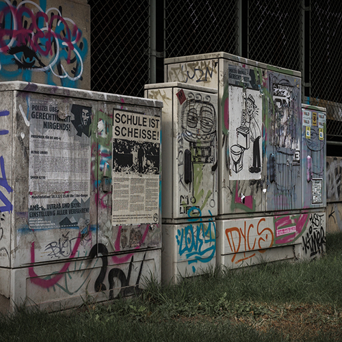 tags and posters on electricity boxes