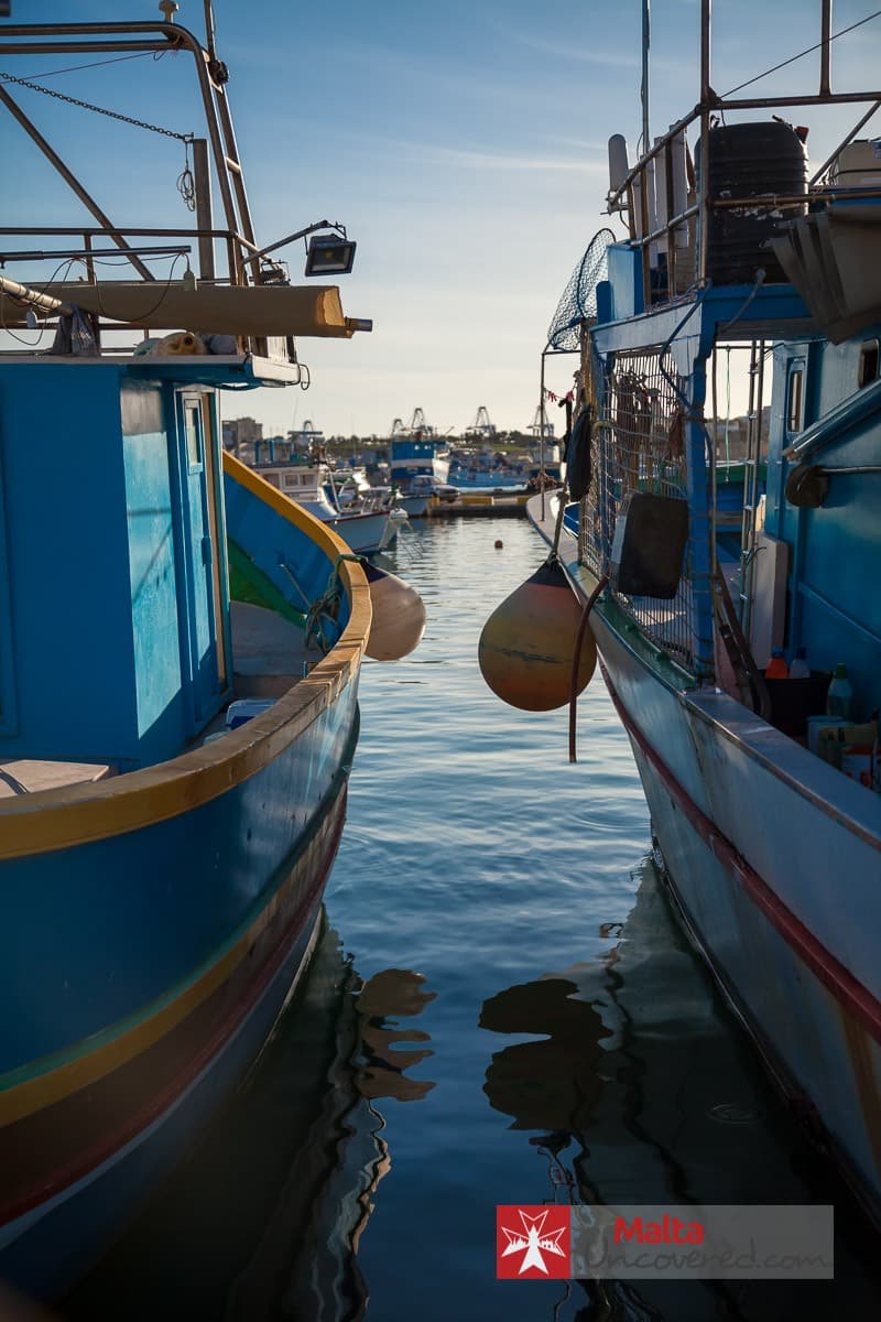 The many fishing boats make Marsaxlokk a cool place to visit in Malta