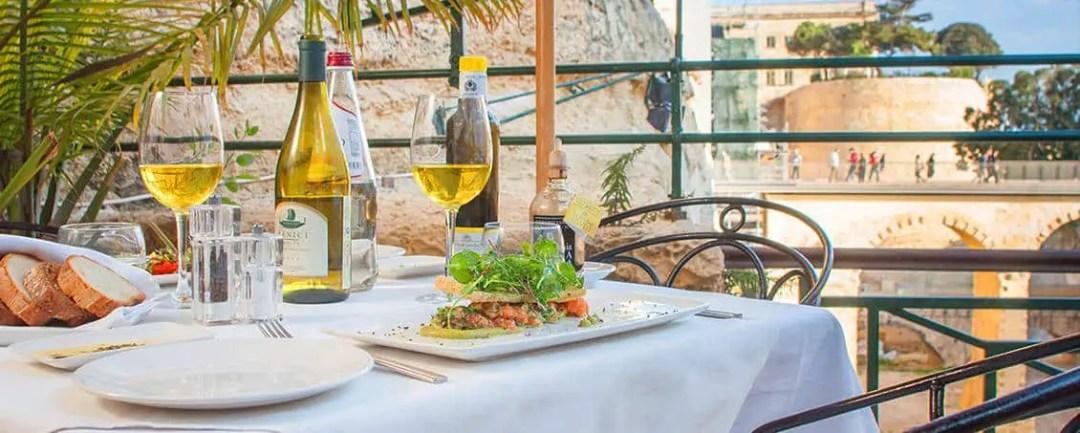 The open air terrace at Rampila restaurant overlooks Valletta's City Gate.