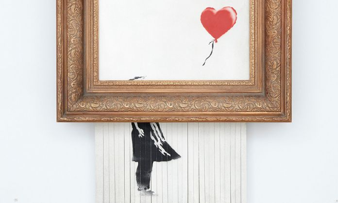GIRL WITH BALLOON DI BANKSY IN MOSTRA
