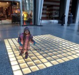 dancing on the lighted floor at the mall