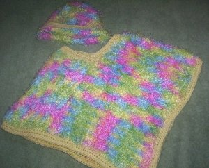 Fuzzy poncho and bonnet set in beautiful pastel colours